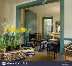 On Table by Daffodils In Pot On Table Beside Double Doorway To Traditional