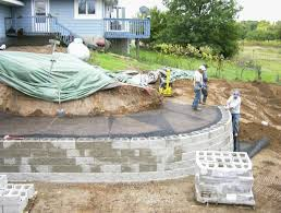 a modular block retaining wall reshapes sloping backyard newest