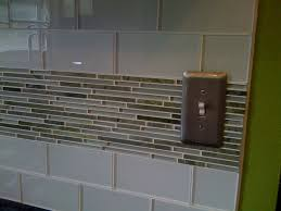 interior small glass subway tile backsplash with white large tile