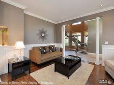 family room with blue rug and yellow accents brown couches and