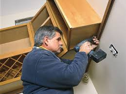 how to fix kitchen base cabinets to wall how to hang kitchen cabinets this house