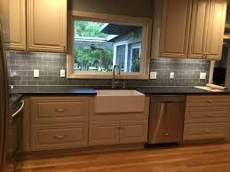 kitchen painted faux brick backsplash with wood countertops