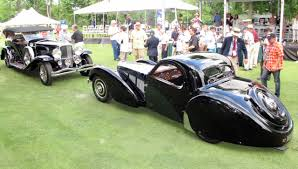 old bugatti old guard rules as duesenberg bugatti win at concours of america