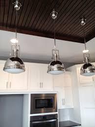 pendulum light over a kitchen island beadboard ceiling over