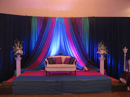 wedding backdrop ottawa teal purple and fushia fabric panels with a navy blue curved