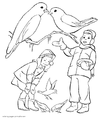 children feeding the birds in winter