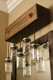 mason jar light wall fixture on etsy would be nice on a deck or