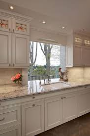 white kitchen cabinets what color walls 28 best home kitchen white ice granite images on pinterest