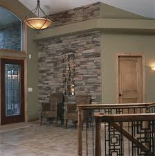 like the stone paint color and light fixture hmmm oak trim even