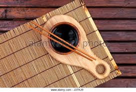 Bamboo Table Top by Sushi Chopsticks And Soy Sauce On Bamboo Table Stock Photos