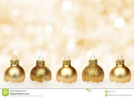 gold christmas gold christmas background with baubles in snow stock photo image