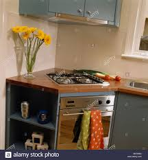 modern corner kitchen hob and oven in fitted corner unit in modern kitchen stock photo