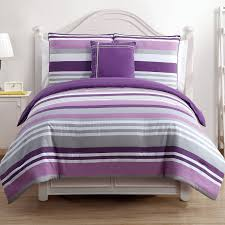 purple grey and white striped bedding bed on white wooden bed