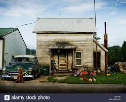 A Small House A Run Down Shack In Small Town America Old Car Sets Outside A