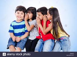 4 indian indian kids friends whisper stock photo royalty free