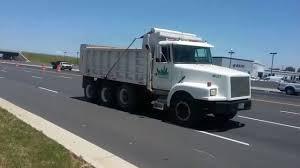 volvo white truck white gmc volvo wg64 dump truck freightliner fld120 hauling a