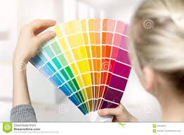 Interior Home Color by Woman Selecting Home Interior Paint Color From Swatch Catalog