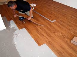 laying vinyl flooring on floor on how to install vinyl