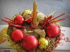 a collection of vintage blown glass ornaments with metal tops