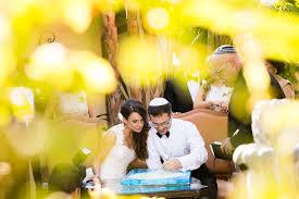 wedding signing the ketubah signing tradition wedding photography