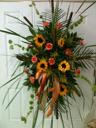 Funeral Flower Bouquets - funeral spray with cattails sunflowers orange carnations and