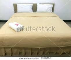 big bed pillows big bed pillows towels and soap on the background fuzzy