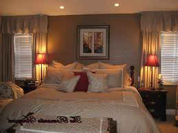 appealing romantic bedroom with wooden color and fireplace modest