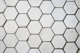 white hexagonal tile floor detail for background use stock photo