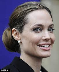 side view of pulled back hair in a bun updos for every face shape from low chignons to loose ponytails
