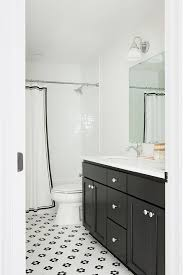 black bath vanity with black and white hex tiles transitional