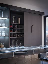 contemporary wet bar by wood mode shown in black bean finish on