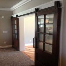 Erias Home Designs Top Of Door Sliding Barn Door Hardware by Frosted Glass Barn Door Gallery Doors Design Ideas