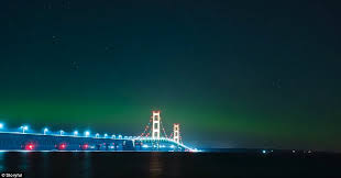 what creates the northern lights northern lightsin the us paint the michigan sky green daily mail