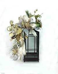 christmas lantern swag w poinsettia ornaments pine cone gold