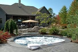 architecture stone chimney and backyard tub with surrounded