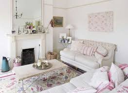 shabby chic living room with sofas and floral area rug charming
