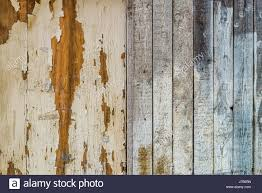 weathered distressed wood background texture with peeling