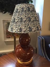 decorative details the return of the printed lampshade www this white ribbed column lamp gets a little pattern and interest with a yellow print