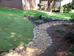 wonderful home and garden designs 2 river rock flower bed ideas