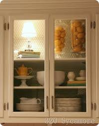 installing your own kitchen cabinets how install a light in a cabinet and also make your own glass doors