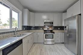 granite countertop off white kitchen cabinets with glaze small