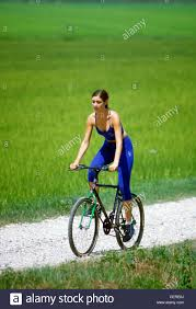 bike riding vest female brunette hair tied up wearing blue cropped leggings and