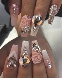 light pink nails with 3d rose design and lots of gems nails