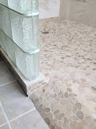 barrier free ready for tile roll in shower base with pebble tiles
