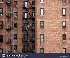 brick walls and windows on apartment buildings in manhattan in new