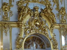 gold gilded ornamentation in ballroom in catherine palace