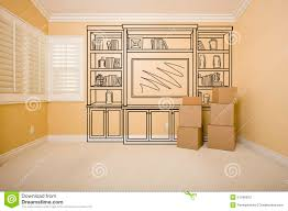 moving boxes in empty room with shelf design drawing on wall stock
