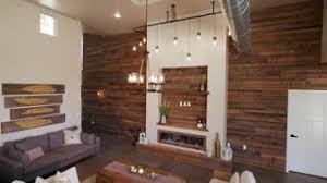 Industrial Look Living Room by Rising Home Entrance Look Up At Wood Wall And Chandelier Looking