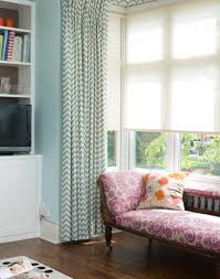 bring your living room to life with a well chosen window treatment