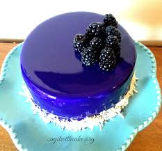 blackberry mousse cake with mirror glaze say it with cake